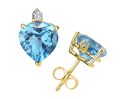 These wonderful earrings feature two lovely all natural 10mm Heart Blue Topaz gemstones prong set in 14K Yellow Gold. A pair of dazzling white diamonds give a dash of sparkling brilliance to these earrings, making them a jewelry essential perfect for almost any occasion. Diamond weight 0.06 Color J-K-L, Clarity I2-I3. A spectacular look that will be treasured forever. The earrings come standard with push back posts but can be upgraded to screw back posts for an additional charge by contacting our Customer Service Department