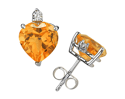 These wonderful earrings feature two lovely all natural 10mm Heart Citrine gemstones prong set in 14K White Gold. A pair of dazzling white diamonds give a dash of sparkling brilliance to these earrings, making them a jewelry essential perfect for almost any occasion. Diamond weight 0.06 Color J-K-L, Clarity I2-I3. A spectacular look that will be treasured forever. The earrings come standard with push back posts but can be upgraded to screw back posts for an additional charge by contacting our Customer Service Department