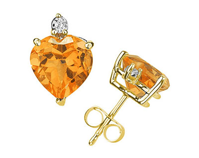 These wonderful earrings feature two lovely all natural 10mm Heart Citrine gemstones prong set in 14K Yellow Gold. A pair of dazzling white diamonds give a dash of sparkling brilliance to these earrings, making them a jewelry essential perfect for almost any occasion. Diamond weight 0.06 Color J-K-L, Clarity I2-I3. A spectacular look that will be treasured forever. The earrings come standard with push back posts but can be upgraded to screw back posts for an additional charge by contacting our Customer Service Department