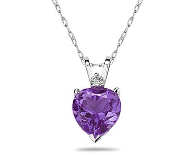 A sparkling white diamond is perfectly prong set above this beautiful all natural 10mm Heart Amethyst. The pendant is crafted in smooth 14K White Gold and hangs from a lovely rope chain also crafted in 14K White Gold. The Amethyst is hand selected and set to ensure the highest quality of natural gemstone. The dazzling white diamond weighs 0.04CTW, Color J-K-L, Clarity I2-I3. An absolutely lovely piece that is an essential in every jewelry collection.