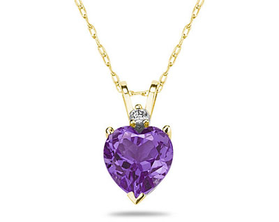 A sparkling white diamond is perfectly prong set above this beautiful all natural 10mm Heart Amethyst. The pendant is crafted in smooth 14K Yellow Gold and hangs from a lovely rope chain also crafted in 14K Yellow Gold. The Amethyst is hand selected and set to ensure the highest quality of natural gemstone. The dazzling white diamond weighs 0.04CTW, Color J-K-L, Clarity I2-I3. An absolutely lovely piece that is an essential in every jewelry collection.