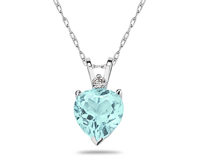 A sparkling white diamond is perfectly prong set above this beautiful all natural 10mm Heart Aquamarine. The pendant is crafted in smooth 14K White Gold and hangs from a lovely rope chain also crafted in 14K White Gold. The Aquamarine is hand selected and set to ensure the highest quality of natural gemstone. The dazzling white diamond weighs 0.04CTW, Color J-K-L, Clarity I2-I3. An absolutely lovely piece that is an essential in every jewelry collection.