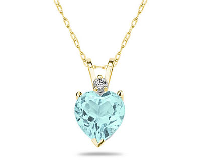 A sparkling white diamond is perfectly prong set above this beautiful all natural 10mm Heart Aquamarine. The pendant is crafted in smooth 14K Yellow Gold and hangs from a lovely rope chain also crafted in 14K Yellow Gold. The Aquamarine is hand selected and set to ensure the highest quality of natural gemstone. The dazzling white diamond weighs 0.04CTW, Color J-K-L, Clarity I2-I3. An absolutely lovely piece that is an essential in every jewelry collection.