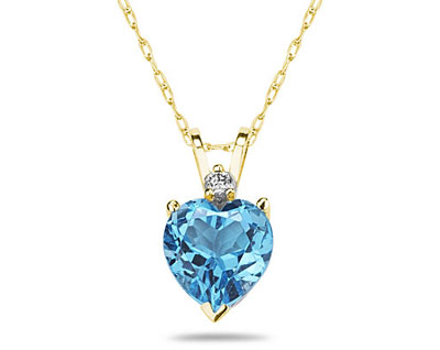 A sparkling white diamond is perfectly prong set above this beautiful all natural 10mm Heart Blue Topaz. The pendant is crafted in smooth 14K Yellow Gold and hangs from a lovely rope chain also crafted in 14K Yellow Gold. The Blue Topaz is hand selected and set to ensure the highest quality of natural gemstone. The dazzling white diamond weighs 0.04CTW, Color J-K-L, Clarity I2-I3. An absolutely lovely piece that is an essential in every jewelry collection.