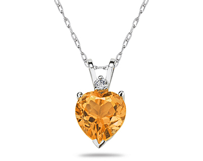A sparkling white diamond is perfectly prong set above this beautiful all natural 10mm Heart Citrine. The pendant is crafted in smooth 14K White Gold and hangs from a lovely rope chain also crafted in 14K White Gold. The Citrine is hand selected and set to ensure the highest quality of natural gemstone. The dazzling white diamond weighs 0.04CTW, Color J-K-L, Clarity I2-I3. An absolutely lovely piece that is an essential in every jewelry collection.