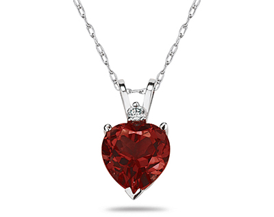 A sparkling white diamond is perfectly prong set above this beautiful all natural 10mm Heart Garnet. The pendant is crafted in smooth 14K White Gold and hangs from a lovely rope chain also crafted in 14K White Gold. The Garnet is hand selected and set to ensure the highest quality of natural gemstone. The dazzling white diamond weighs 0.04CTW, Color J-K-L, Clarity I2-I3. An absolutely lovely piece that is an essential in every jewelry collection.