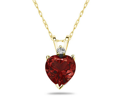 A sparkling white diamond is perfectly prong set above this beautiful all natural 10mm Heart Garnet. The pendant is crafted in smooth 14K Yellow Gold and hangs from a lovely rope chain also crafted in 14K Yellow Gold. The Garnet is hand selected and set to ensure the highest quality of natural gemstone. The dazzling white diamond weighs 0.04CTW, Color J-K-L, Clarity I2-I3. An absolutely lovely piece that is an essential in every jewelry collection.