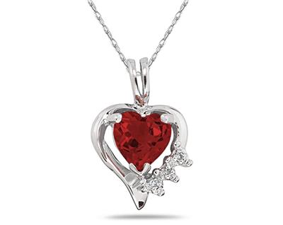 """From your heart to hers, show her your deepest, richest feelings with this 10 karat white gold and gemstone pendant. The heart shaped garnet at top is lit up by the shimmer of prong-set round diamonds. Delicate and perfect. This pendant hangs from an 18"""" rope chain in 10 karat white gold."""