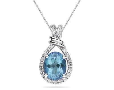 Oval Shaped Blue Topaz and Diamonds Pendant in 14k White Gold
